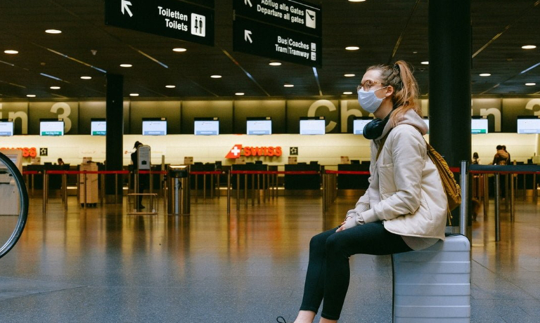 Woman in abandoned airport - COVID-19